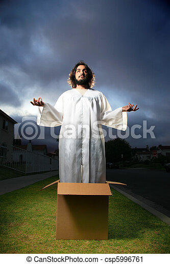 Man looking like Jesus standing in the box with hands raised. - csp5996761