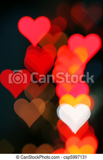 Blurred valentine background with heart-shaped highlights. - csp5997131