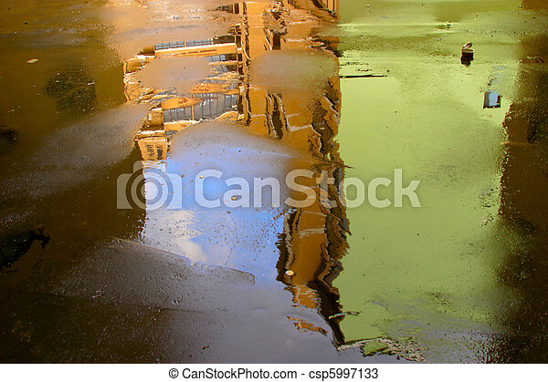 Abstract background made of old buildings reflecting in a wet asphalt. - csp5997133
