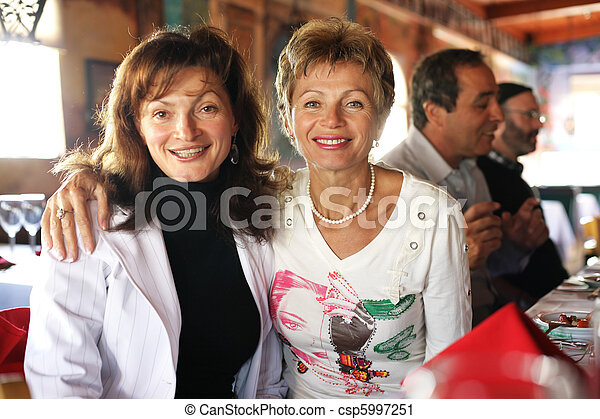 Two happy mature women at party in restaurant - csp5997251