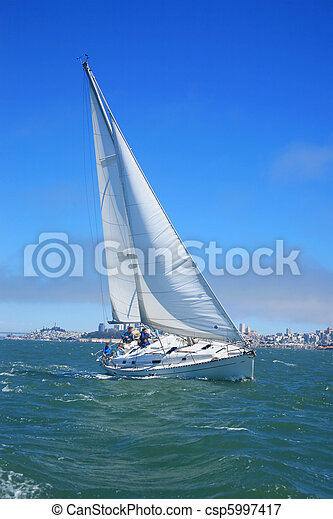 Beautiful yacht in San Francisco bay, city on the horizon. California, USA - csp5997417