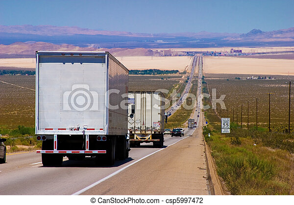 Interstate delivery trucks on a highway. - csp5997472