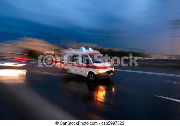 Ambulance car speeding, blurred motion - csp5997523