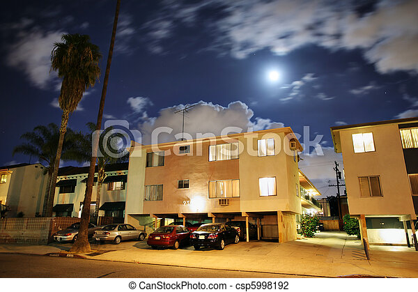 Residential street with apartment buildings at night at Los Angeles, California. - csp5998192