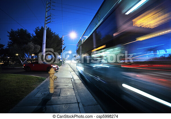 Speeding bus, blurred motion - csp5998274