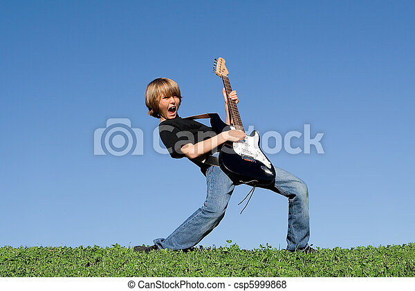 child playing guitar and singing - csp5999868