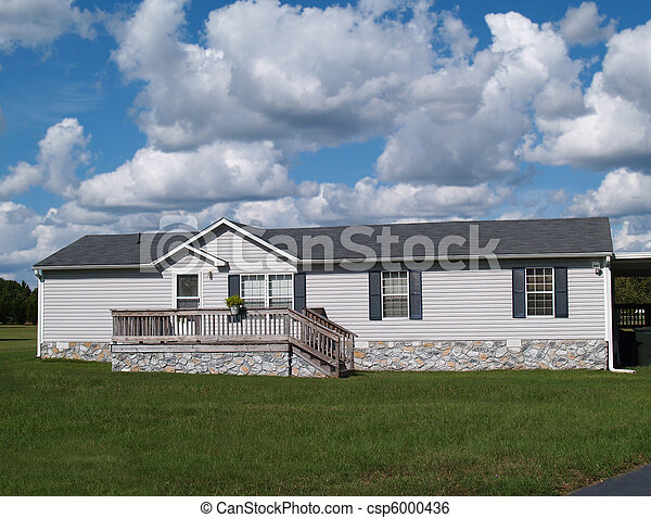 Gray Trailer Home with Stone Founda - csp6000436