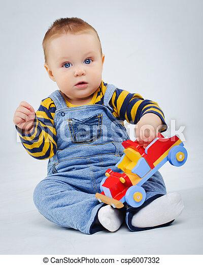 Stock foto van baby jongen plaing zijn speelbal auto studio csp6007332 zoek naar stock - Foto baby jongen ...