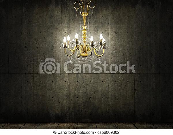 chandelier in dark grungy concrete room - csp6009302