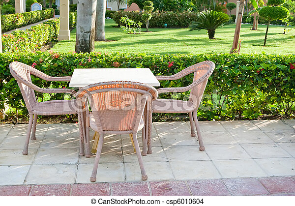 Brown wooden chairs an tables on patio - csp6010604