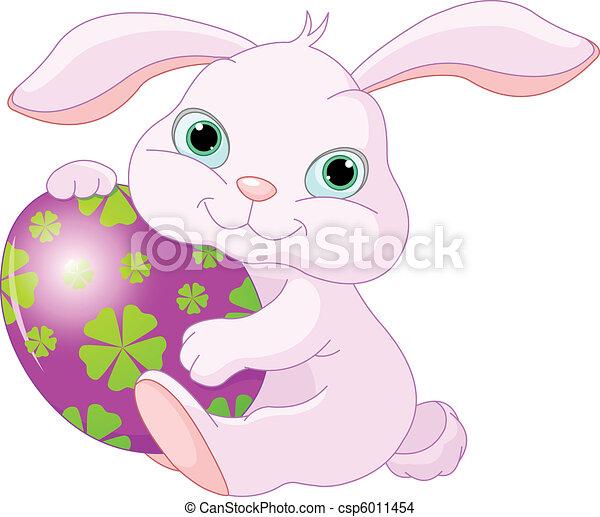 Easter Rabbit holds egg - csp6011454