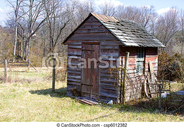Old worn and weathered shack in the country