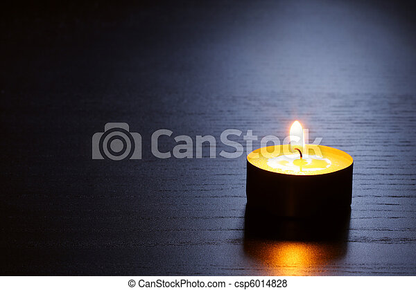 Single candle with back lit. Tranquil scene. - csp6014828