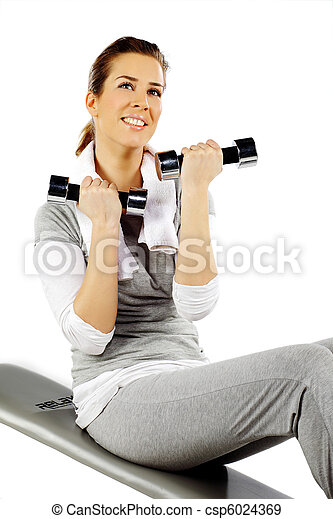 Girl sitting on a bench and exercising with weights - csp6024369