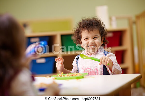 Children eating lunch in kindergarten - csp6027634