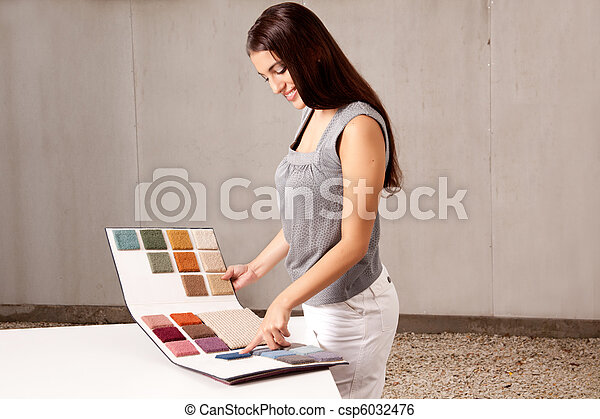 Interior Architect Choosing Rug Sample - csp6032476