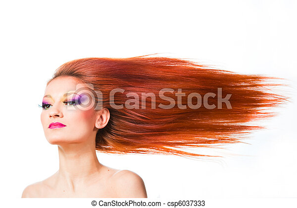 woman with long red hair fluttering on wind - csp6037333