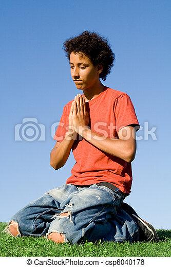 christianity, teen on knees in prayer - csp6040178