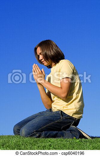 christian youth kneeling and  praying - csp6040196