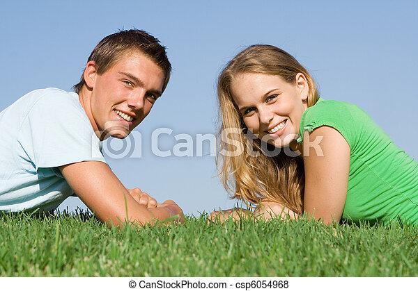 teen couple with perfect white smiles, - csp6054968