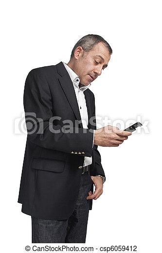 Businessman dialing phone - csp6059412