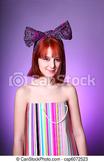 Funny girl in present box with tie on the head.