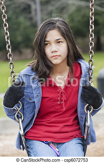Stock Photo - Angry, sad preteen girl sitting on swing - stock image ...