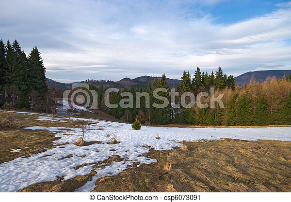 Early spring hills scenery with the rest of snow - csp6073091