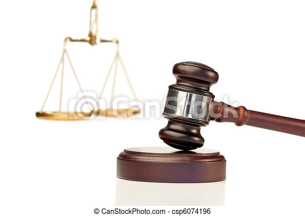 Gavel in action and scale of justice - csp6074196