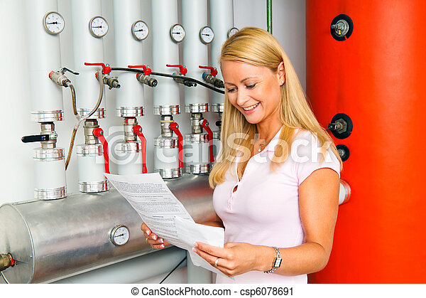 Woman in the boiler room for heating. - csp6078691