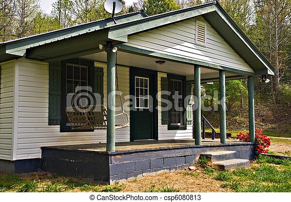 photos de petit maison devant porche devant porche secteur de csp6080813. Black Bedroom Furniture Sets. Home Design Ideas
