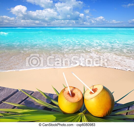 Caribbean paradise beach coconuts cocktail - csp6080983
