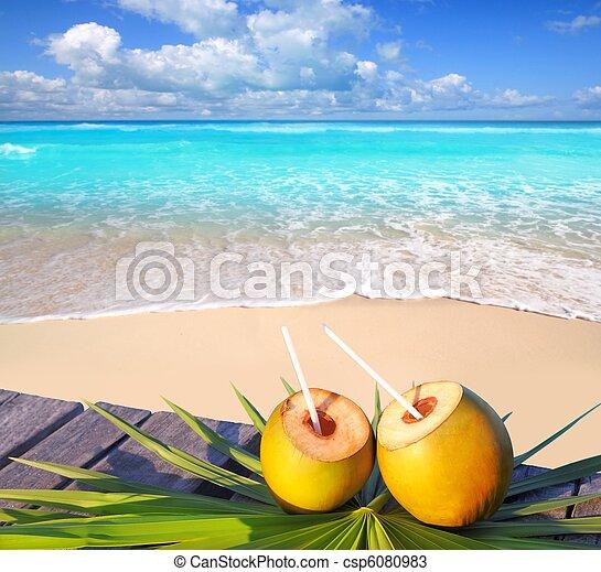 Caribbean paradise beach coconuts cocktail - csp6080983