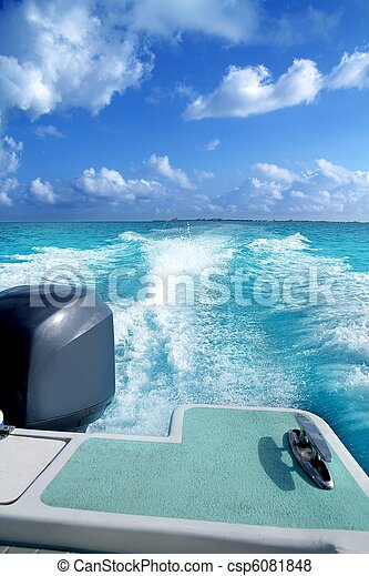 boat outboard stern with prop wash caribbean foam - csp6081848
