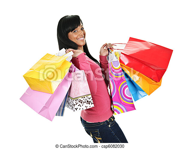 Happy young black woman with shopping bags - csp6082030