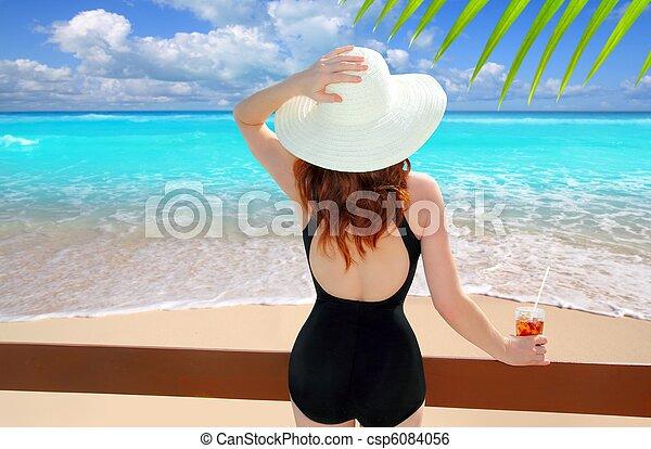 beach hat rear view woman cocktail tropical beach - csp6084056