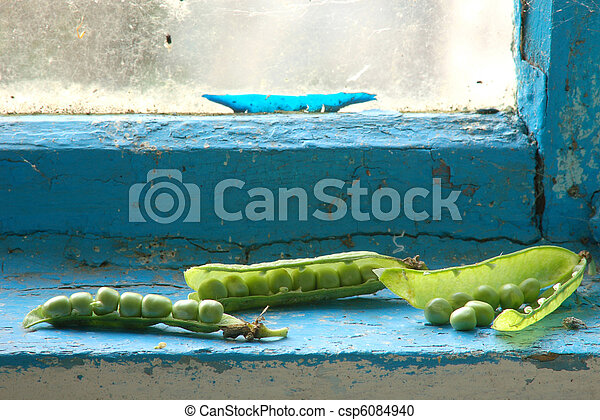 Green peas on window sill - csp6084940