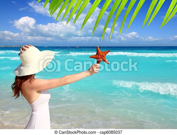 beach hat woman starfish in hand tropical Caribbean - csp6085037