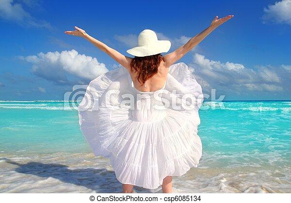 beach rear woman wind shaking white dress - csp6085134