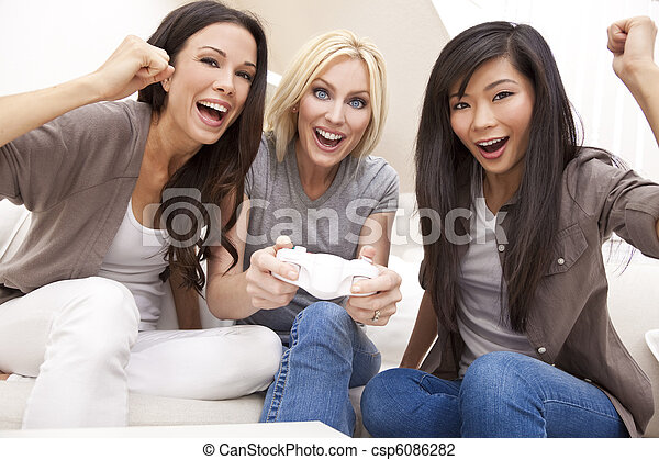 Three Beautiful Women Friends Playing Video Games at Home - csp6086282
