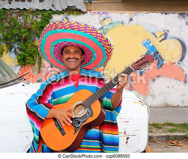 Mexican humor man smiling playing guitar sombrero - csp6088593