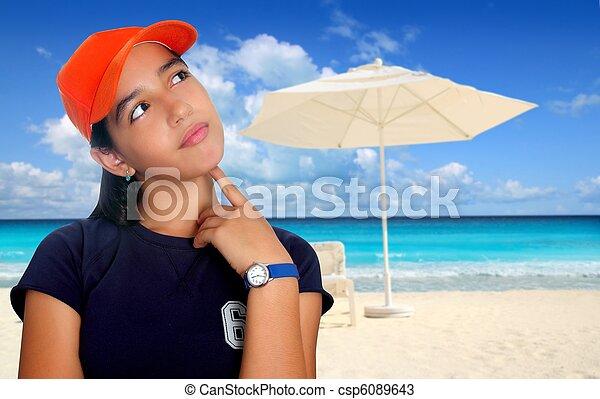 Stock Photo - Latin teen hispanic pensive girl orange cap