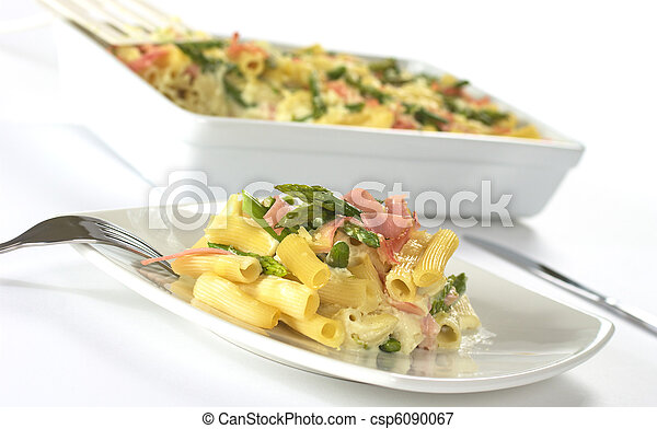 Green asparagus, ham and pasta casserole (Selective Focus, Focus on the front of the food on the plate) - csp6090067