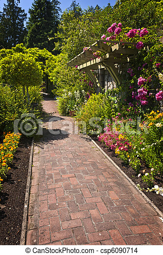Flower garden with paved path - csp6090714