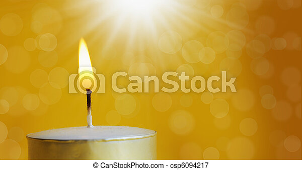 one burning candle with bright white light - csp6094217