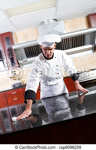chef washing kitchen counter - csp6096239