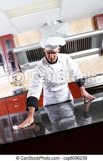 chef washing kitchen counter - csp6096239