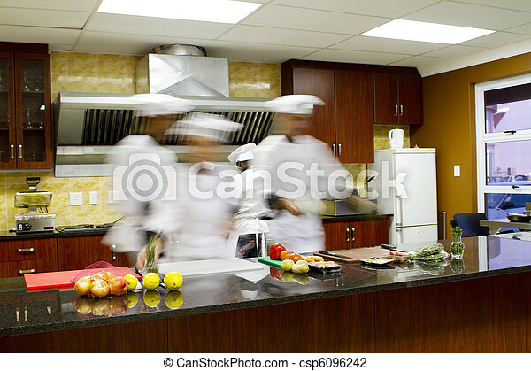chefs cooking in kitchen - csp6096242