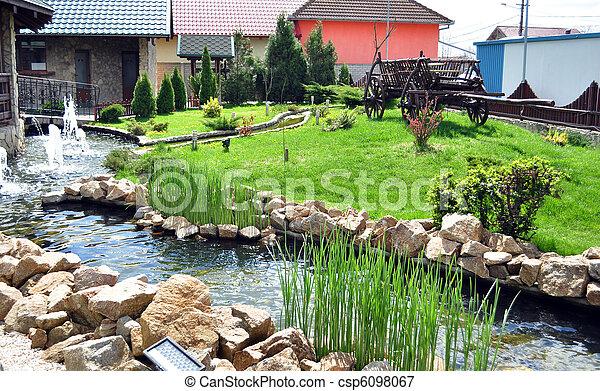 image de rivi re jardin artificiel rivi re rochers et herbe csp6098067 recherchez. Black Bedroom Furniture Sets. Home Design Ideas