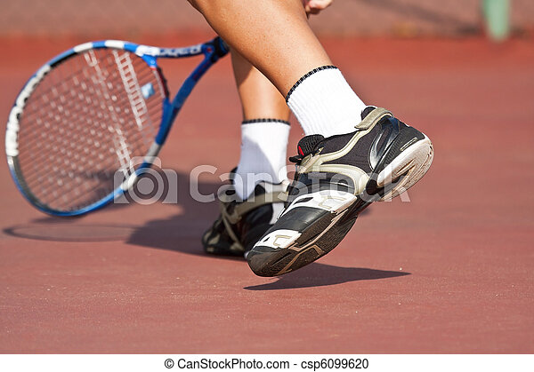 Tennis player legs and feet on court playing - csp6099620